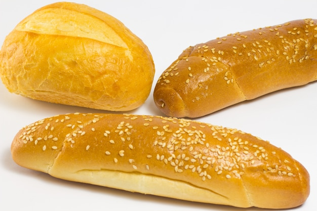 Bun and two baguette with sesame seeds and sunflower seeds