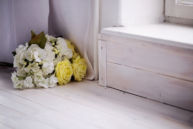 Bunch of beautiful artificial rose flowers on a floor