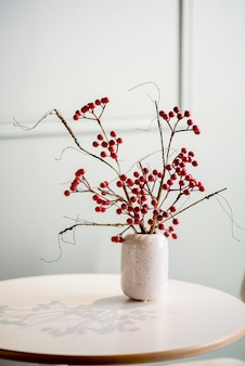Bunch of berries on the table in a vase