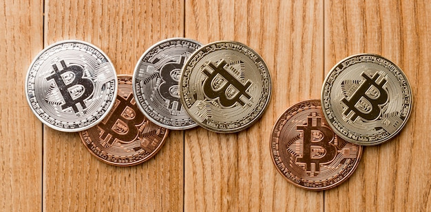 Bunch of bitcoins on wooden table