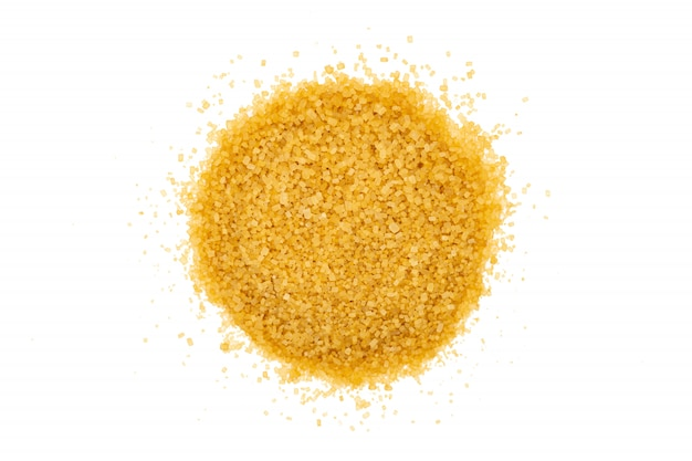 Bunch of brown sugar, isolated, close up, macro, top view.