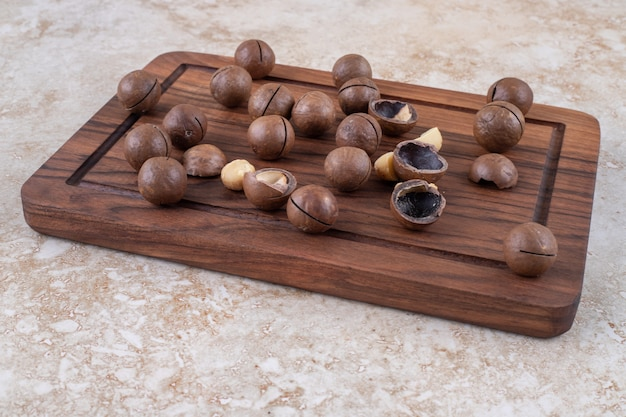 Bunch of chocolate candies on wooden board