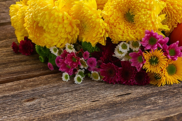 Bunch of chrysanthemum  flowers on wooden background