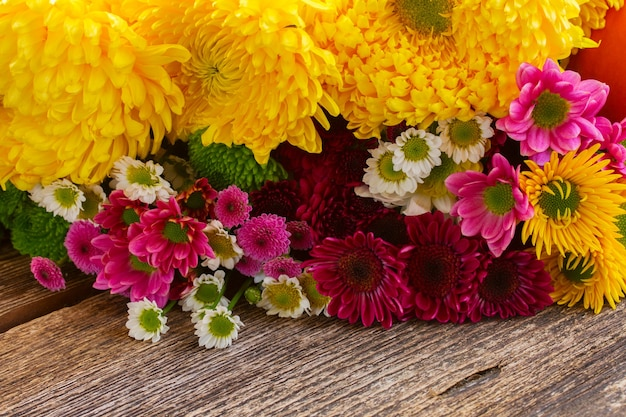 Bunch of chrysanthemum  flowers on wooden table