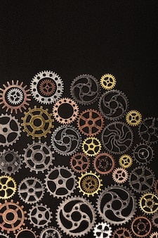 Bunch of cogwheels on a black background.