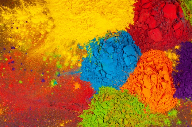 A bunch of colours placed on wooden background close up