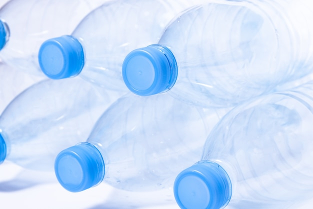 Bunch of disposable crumpled plastic bottles