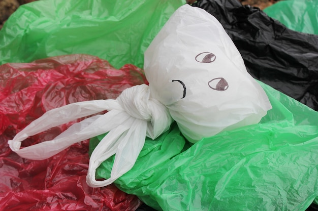 A bunch of disposable multi-colored plastic bags polluting the environment