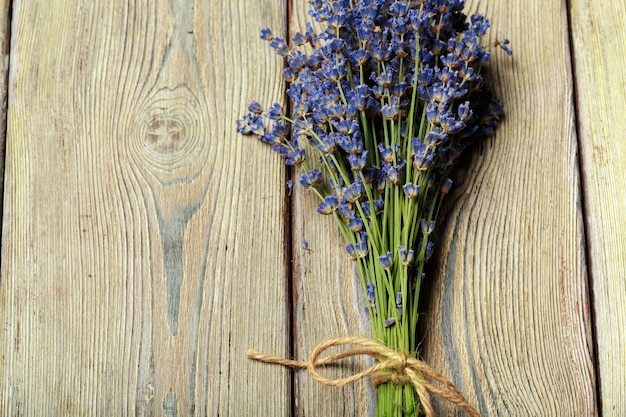 Bunch of dried lavender on wooden background