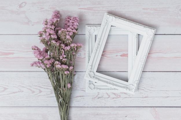 Bunch of flowers near photo frames