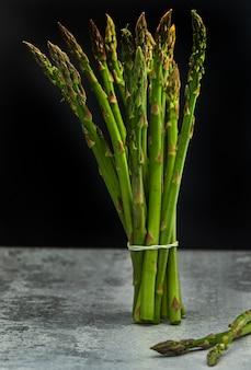 Bunch of fresh asparagus on a concrete base
