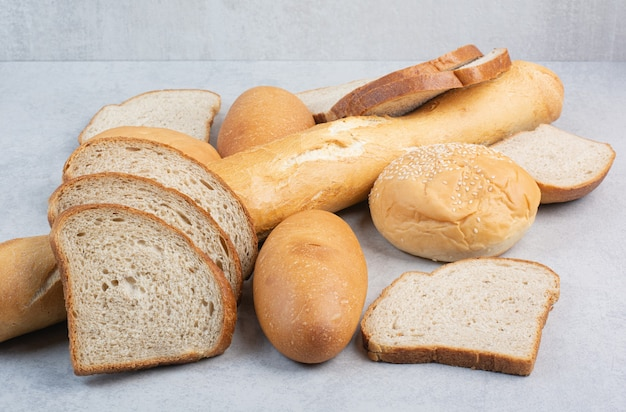 Bunch of fresh bread on marble background. high quality photo
