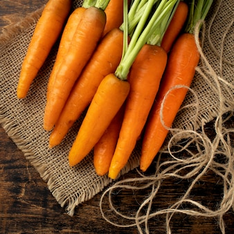 Bunch of fresh carrots on cloth