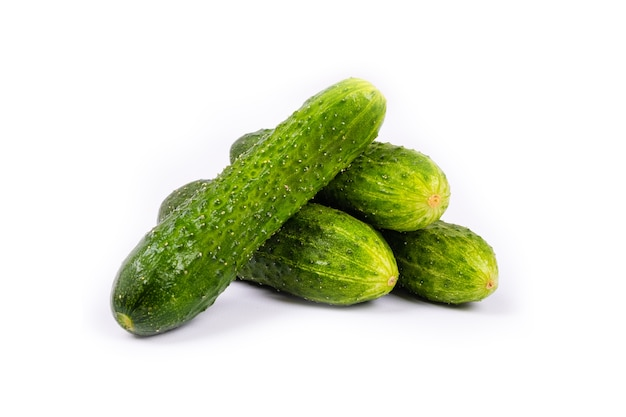 Bunch of fresh cucumbers isolated on white wall.