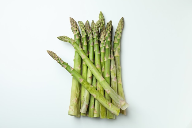 Bunch of fresh green asparagus on white