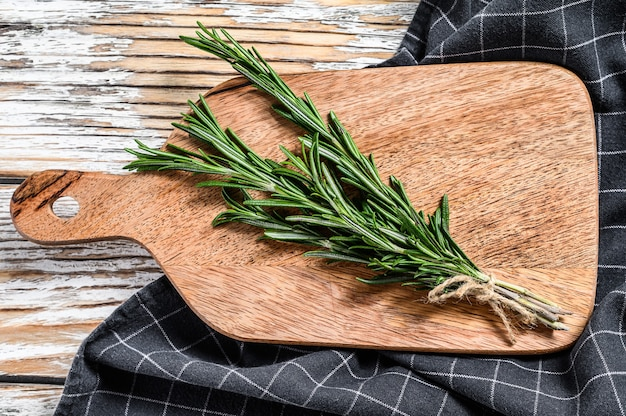 A bunch of fresh herbs on wooden board