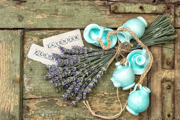 Bunch of fresh lavender flowers over rustic wooden background
