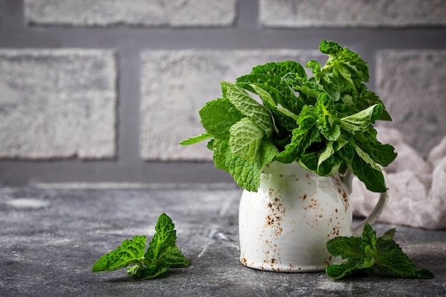 Bunch of fresh mint on brick wall background