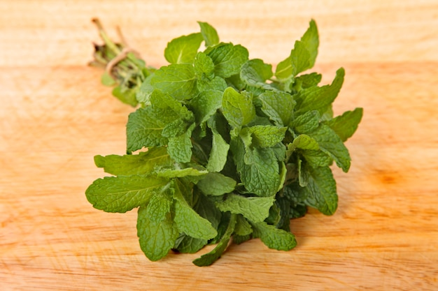 Bunch of fresh mint on wooden board