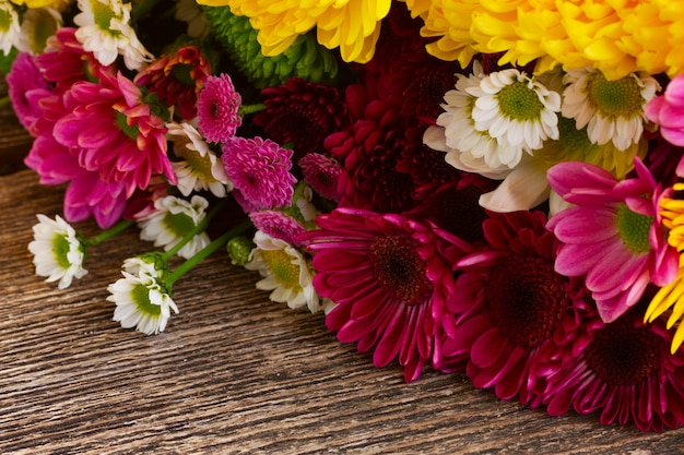 Bunch of fresh mum flowers on wooden table