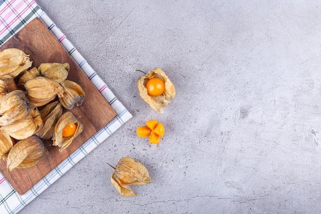 Bunch of fresh ripe kumquats placed on stone.