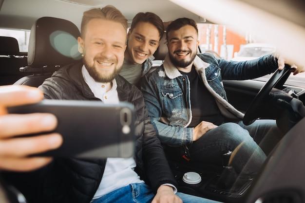 A bunch of friends having fun in the car.