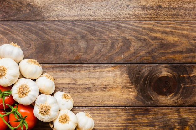 Bunch of garlic near tomatoes