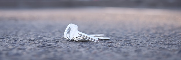 Bunch of keys lies on road in parking lot key recovery service concept