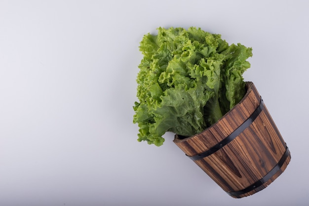 A bunch of lettuce in a wooden bucket