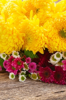 Bunch of mum flowers on wooden table
