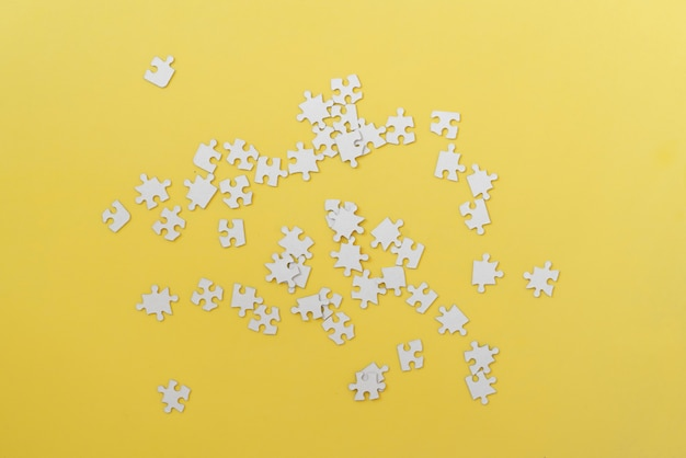 A bunch of new blank puzzle, solving, smart mind development. messy simple flat lay