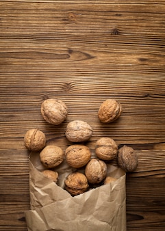 Bunch of nuts on wooden background