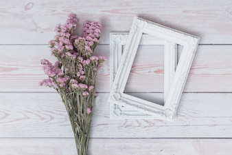 Bunch of flowers near photo frames