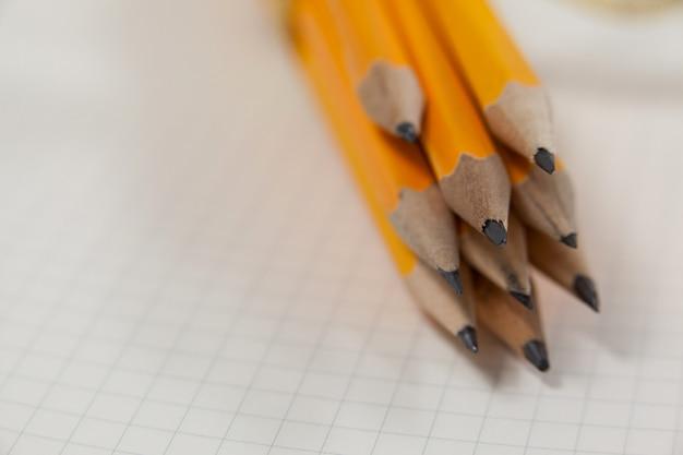 Связка карандашей на книге