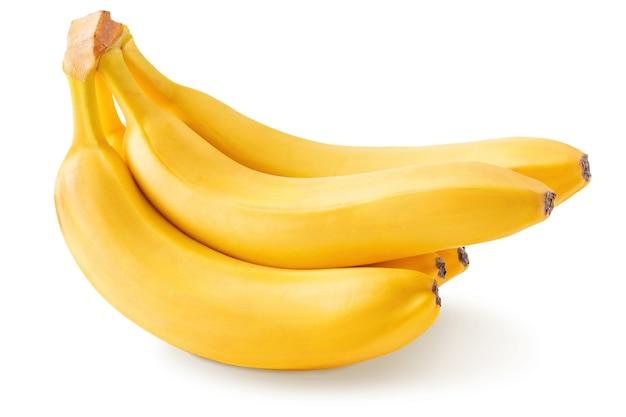 Букет из спелых желтых бананов, изолированные на белом фоне, крупным планом. сладкие тропические фрукты