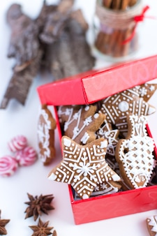 Bunch of traditional Christmas gingerbread with icing in a red paper box