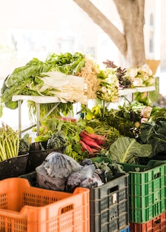 Bunch of organic vegetables for sale on market stall