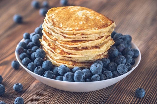 Bunch of pancakes with fresh blueberries