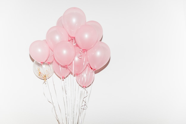 Bunch of pink balloons isolated on white background