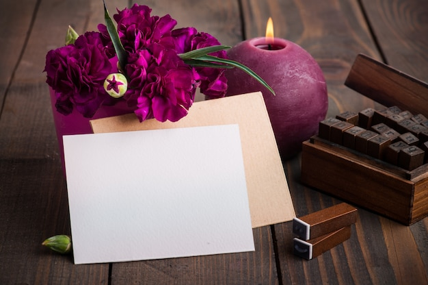 Bunch of purple carnations and card