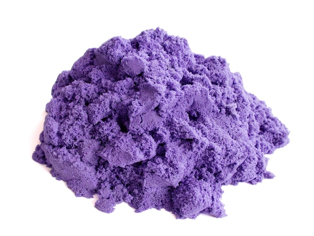 A bunch of purple kinetic sand on a white background for children's creativity and development