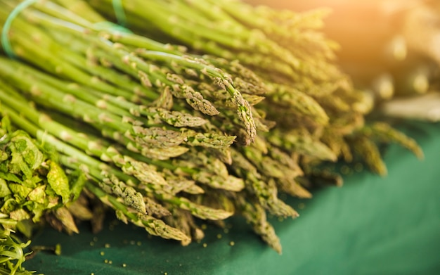 Bunch of raw garden asparagus on table for sale