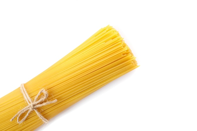 Bunch of raw spaghetti tied with rope isolated on white