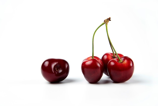 A bunch of red cherries on white background