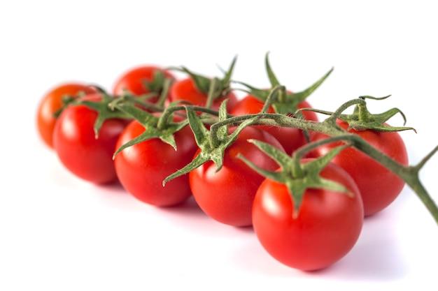 Bunch of red tasty fresh tomatos on white.