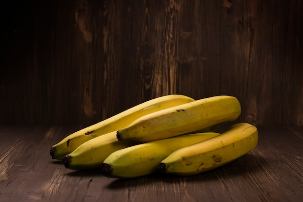 Bunch of ripe bananas over rustic wooden background