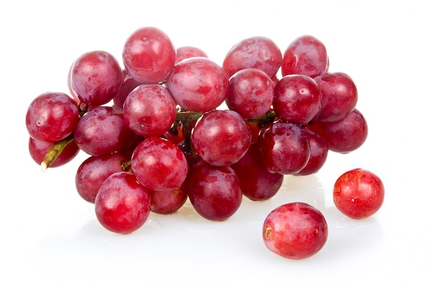 Bunch of ripe pink grapes isolated on white background