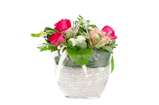 Bunch of roses in a vase isolated on white space