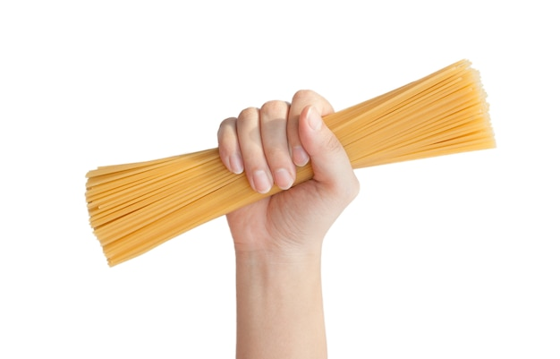 Bunch of spaghetti in female hand