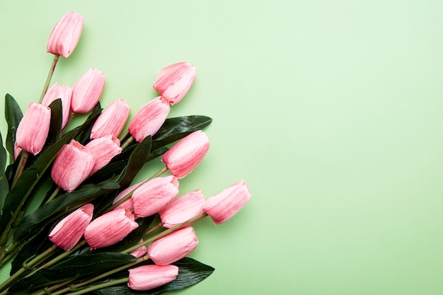 Bunch of tulip flowers on green